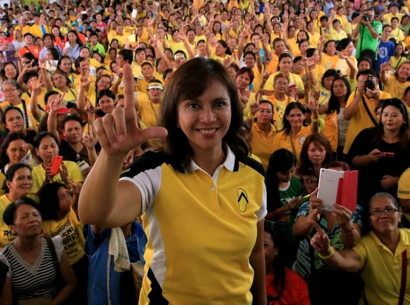 FILE PHOTO - Philippine Vice-presidential candidate and congresswoman Leni Robredo flashes a Laban (Fight) sign during her campaign rally in Quezon City, Metro Manila