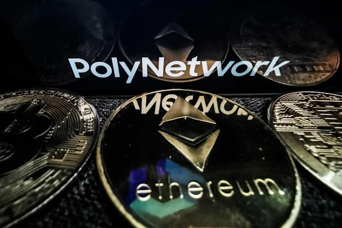 Poly Network logo displayed on a phone screen and representation of Ethereum cryptocurrency is seen in this illustration photo taken in Sulkowice, Poland on August 12, 2021. (Photo by Jakub Porzycki/NurPhoto via Getty Images)