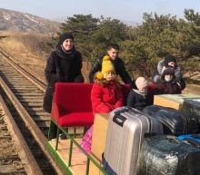 North Korea: Russian diplomats leave by hand-pushed trolley