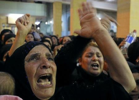 Relatives of victims of an attack that killed at least 28 Coptic Christians on Friday react at the funeral in Minya, Egypt May 26, 2017. REUTERS/Mohamed Abd El Ghany
