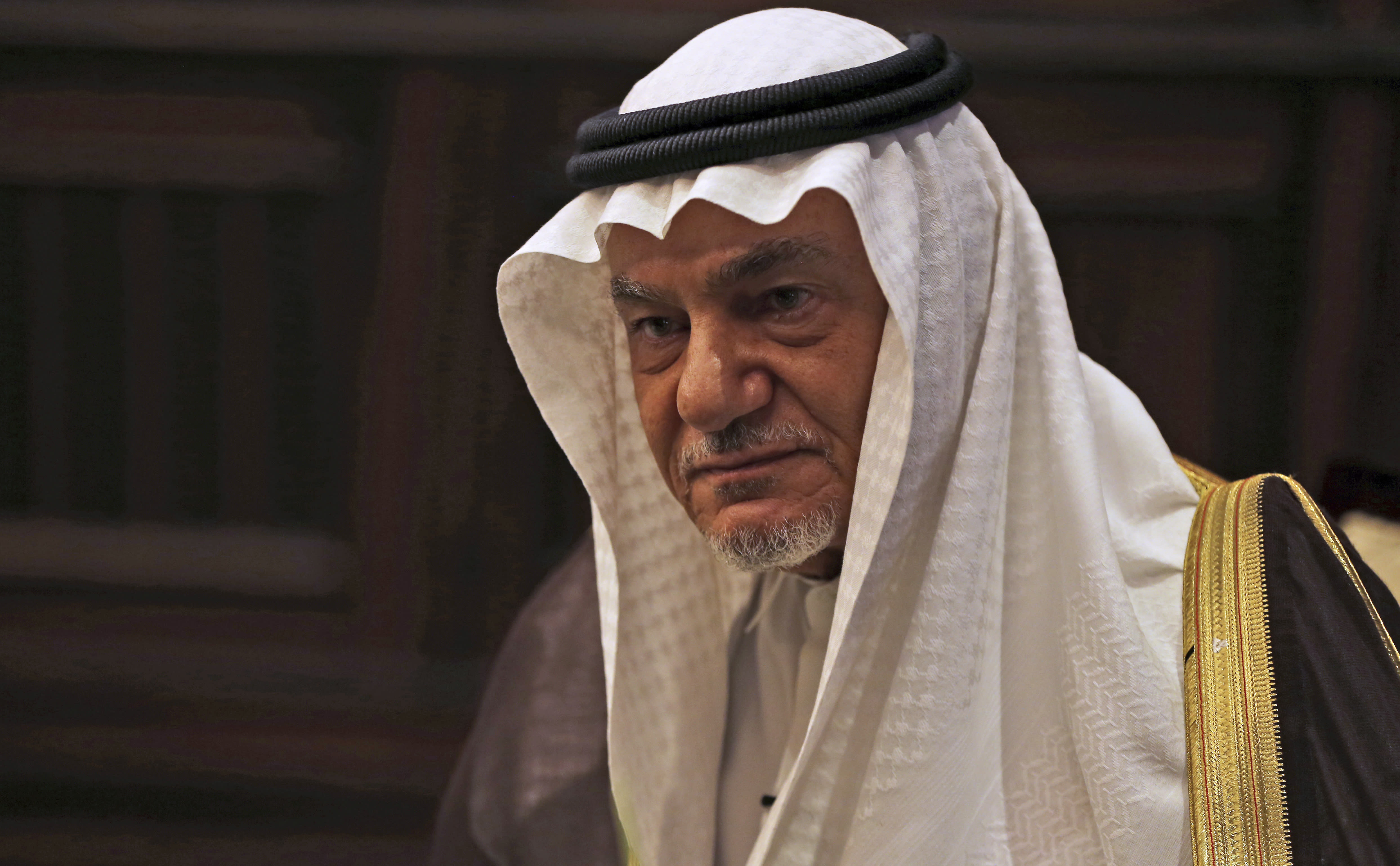 """Saudi Prince Turki al-Faisal talks to the Associated Press in Abu Dhabi, United Arab Emirates, Saturday Nov. 24, 2018. A prominent Saudi royal says whether or not heads of state gathered in Argentina next week for the Group of 20 summit warmly engage with Crown Prince Mohammed bin Salman, he is someone """"that they have to deal with."""" Prince Turki al-Faisal told The Associated Press the kingdom """"will have to bear"""" that its reputation has been tarred by the killing of Saudi writer Jamal Khashoggi in its Istanbul consulate last month. (AP Photo/Kamran Jebreili)"""