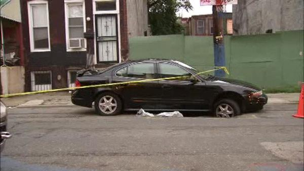 Car lands in North Philadelphia sinkhole, 2 injured