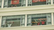 China fans rent hotel rooms to dodge virus ban on spectators
