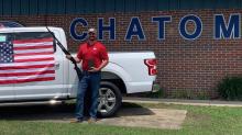 Alabama car dealership offers free shotgun, bible, and American flag to customers