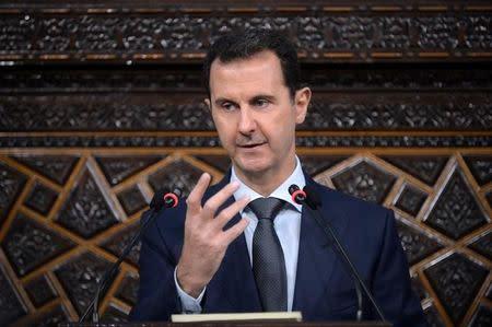 Syria's president Bashar al-Assad speaks to Parliament members in Damascus