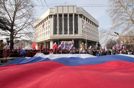 FILE PHOTO: People take part in celebrations of the fifth anniversary of Russia's annexation of Crimea in Simferopol, Crimea March 15, 2019. REUTERS/Alexey Pavlishak/File Photo