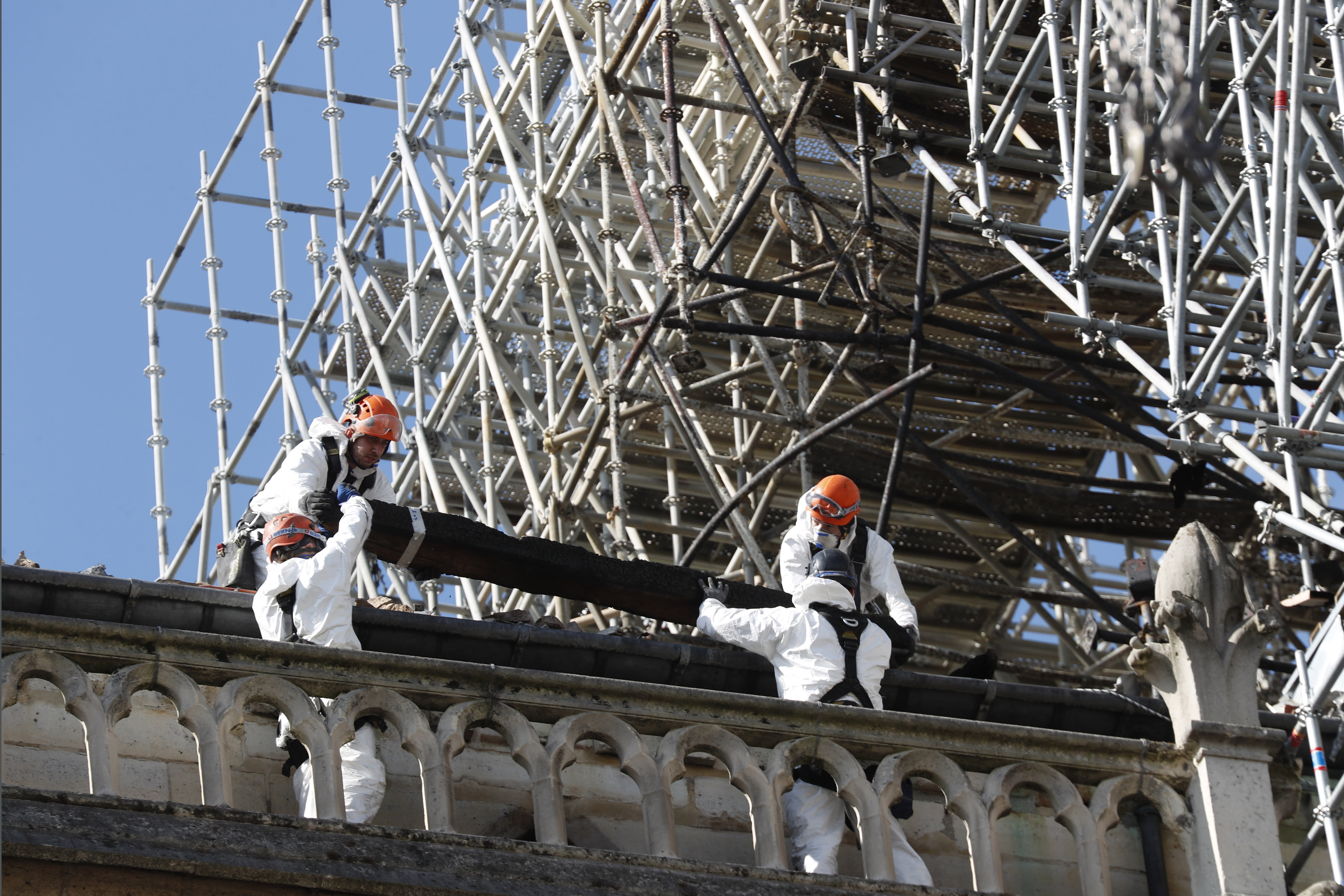 Workers install protections on Notre Dame cathedral Wednesday, April 24, 2019 in Paris. Professional mountain climbers were hired to install synthetic, waterproof tarps over the gutted, exposed exterior of Notre Dame Cathedral, as authorities raced to prevent further damage ahead of storms that are rolling in toward Paris. (AP Photo/Thibault Camus)