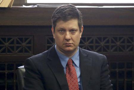 Chicago police officer Jason Van Dyke sits in the courtroom during a hearing in his shooting case of Laquan McDonald in Chicago Illinois
