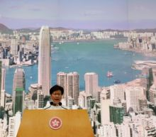 Bowing to pressure, Hong Kong leader suspends extradition bill