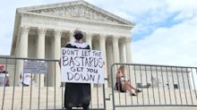 Protesters at Supreme Court call out hypocrisy of Senate Republicans