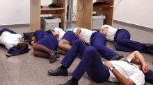 Ryanair sacks staff for gross misconduct after they are pictured 'sleeping on airport floor' in Spain