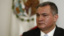 Mexico purges security agencies of those tied to ex-chief