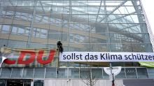 Greenpeace activists spell out climate message on Angela Merkel's office