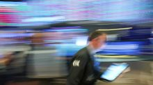 Wall Street slides as data shows early business impact of coronavirus