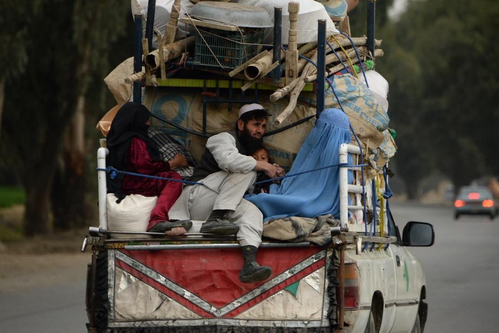 An internally displaced Afghan family flee from military operations against militants in Kot district of Nangarhar province, in February 2016 (AFP Photo/Noorullah Shirzada)