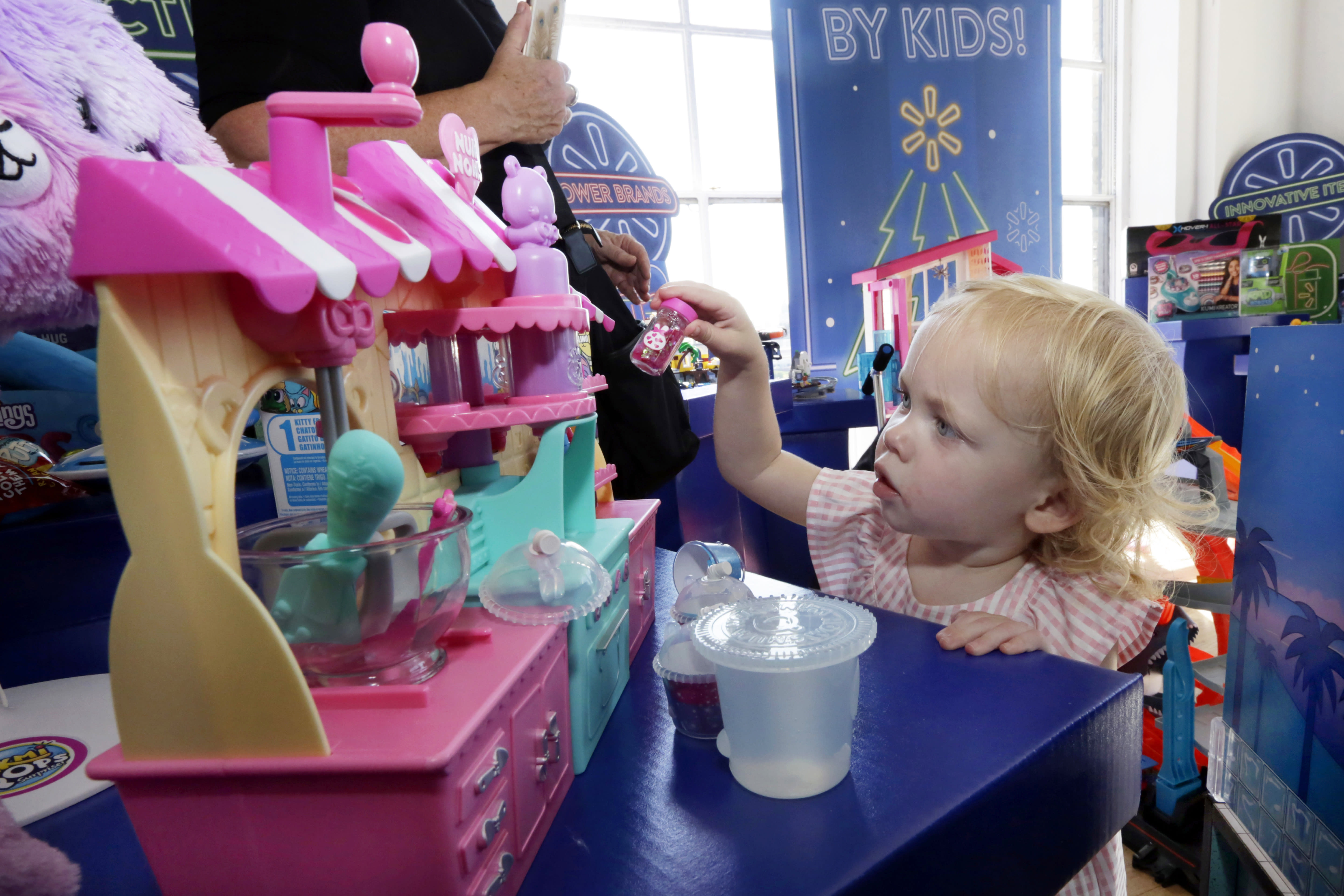 "In this Aug. 30, 2018, photo 20-month-old Eva plays with Num Nom Silly Shakers Maker toy at the Walmart Toy Shop event in New York. Walmart says 30 percent of its holiday toy assortment will be new. It will also offer 40 percent more toys on Walmart.com from a year ago. In November and December, the company's toy area will be rebranded as ""America's Best Toy Shop."" (AP Photo/Richard Drew)"