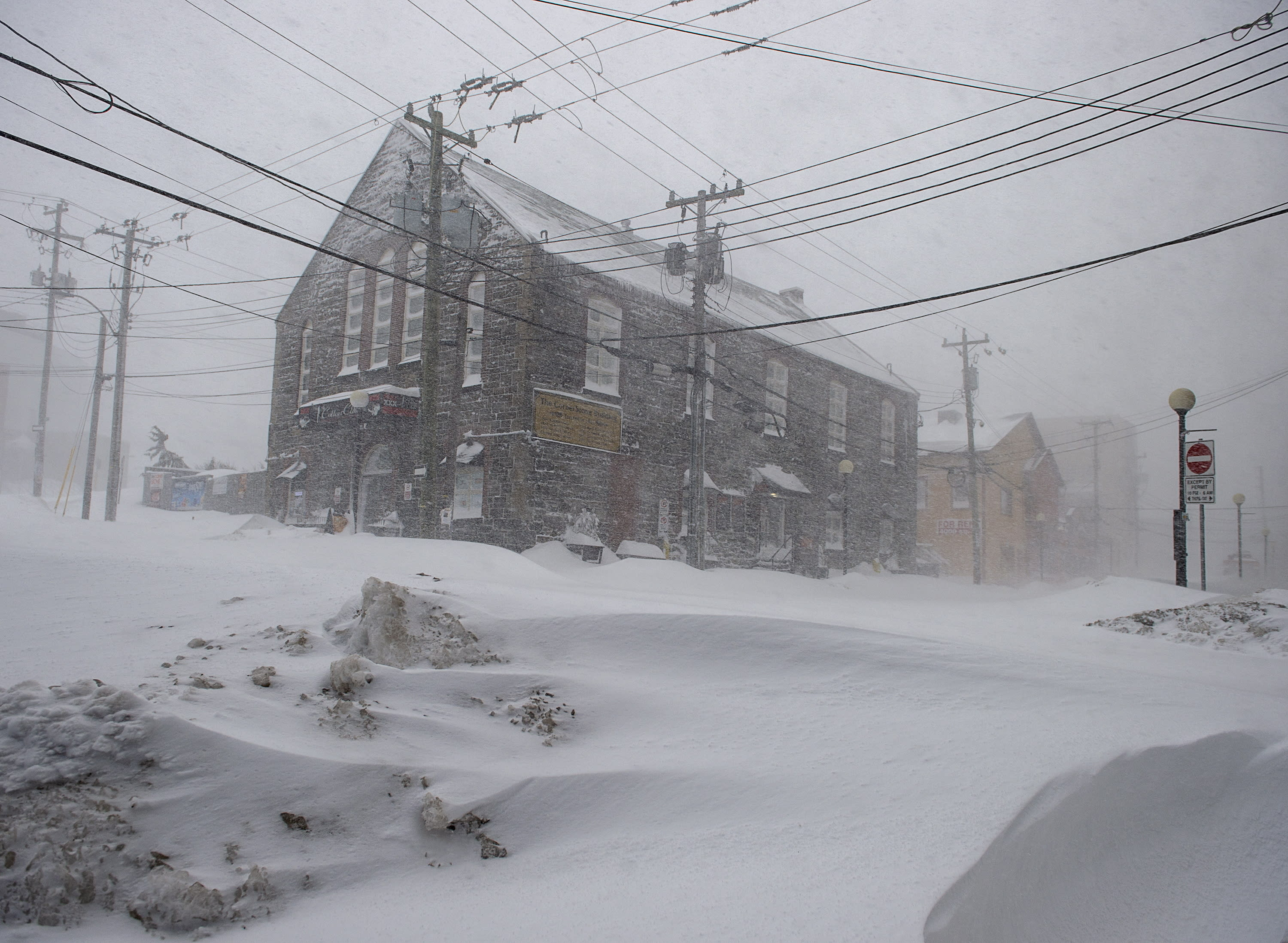 The streets were quiet St. John' Newfoundland on Friday, Jan. 17, 2020, as a major winter storm brought the city to a standstill. The city has declared a state of emergency, ordering businesses closed and vehicles off the roads as blizzard conditions descend on the Newfoundland and Labrador capital. (Andrew Vaughan/The Canadian Press via AP)