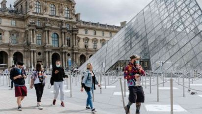 Face masks and floor markers as Louvre reopens
