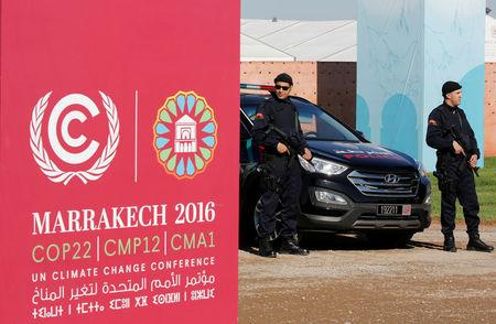 Moroccan security stand guard in front of the entrance of the World Climate Change Conference 2016 (COP22) in Marrakech, Morocco