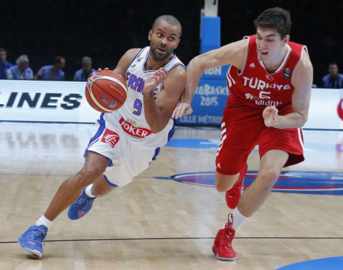 Spurs point guard Tony Parker drives past new Cavaliers wing Cedi Osman during the 2016 Olympics. (AP)