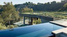 Infinity Pool Bisects Half-Hidden Modern Home