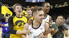 No. 20 Iowa comes back to top Northwestern on Jordan Bohannon's last-second shot