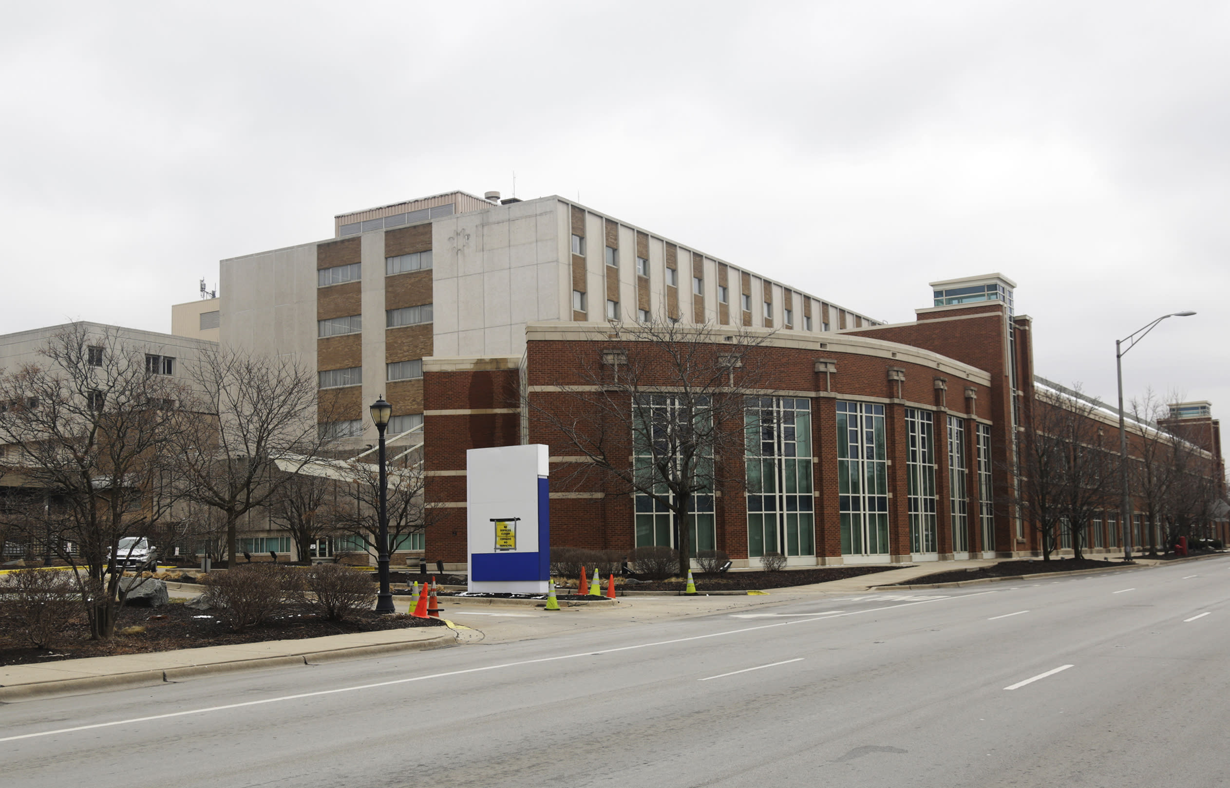This March 23, 2020 photo shows the former MetroSouth Medical Center in Blue Island, Ill. U.S. hospitals are rushing to find beds for a coming flood of COVID-19 patients, opening older closed hospitals and re-purposing other medical buildings. (AP Photo/M. Spencer Green)