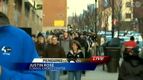 Penguins deliver pizzas to fans in student rush line