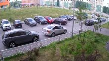 Horrible driver crashes into several cars trying to exit parking lot