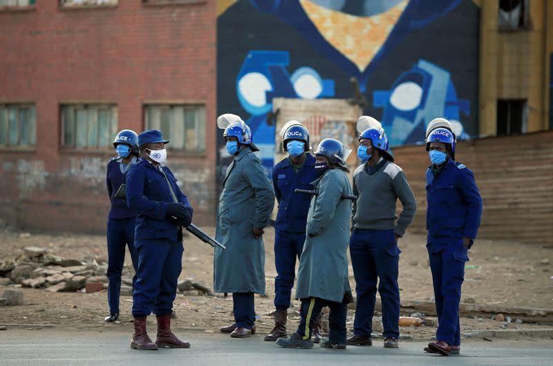 Police patrol the streets ahead of planned anti-government protests in Harare