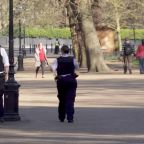 Police try to enforce social distancing in Hyde Park in London during coronavirus lockdown