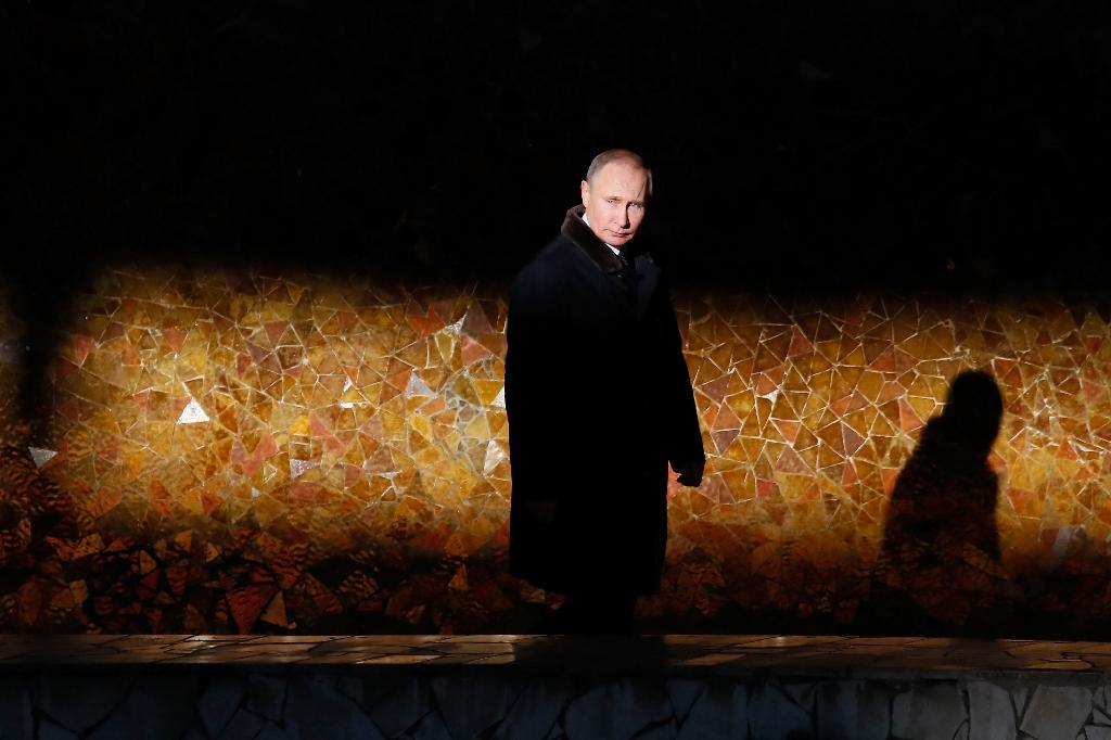 Ahead of the March election, Russia's Vladimir Putin has done next to no campaigning and all his public appearances have been highly choreographed (AFP Photo/MAXIM SHEMETOV)