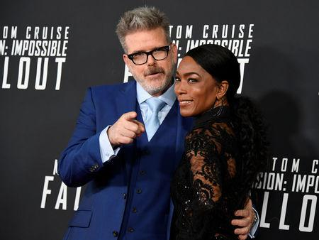 Film director Christopher McQuarrie (L) and actress Angela Bassett pose for photographers on the red carpet at the premiere of Mission:Impossible-Fallout, at the Smithsonian's National Air and Space Museum, in Washington, U.S., July 22, 2018. REUTERS/Mike Theiler