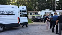 The Latest: Police release names of father, 4 kids killed