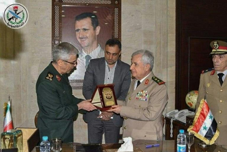 Iran's armed forces chief Major General Mohammad Bagheri (L) and Syria's Defence Minister Ali Ayoub exchange gifts after signing the deal, in a handout picture from Syria's official SANA news agency (AFP Photo/-)