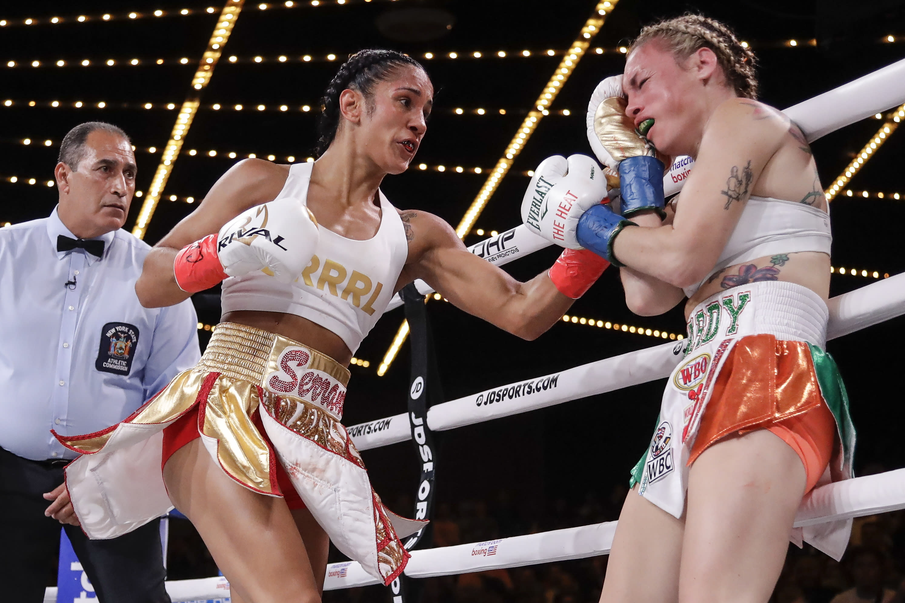 Amanda Serrano, left, punches Heather Hardy during the first round of a boxing match Friday, Sept. 13, 2019, in New York. Serrano won the fight. (AP Photo/Frank Franklin II)