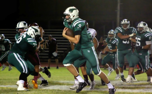 6-foot-10 QB and star basketball recruit Michael Humphrey scrambles during a recent game — Sunnyslope Football