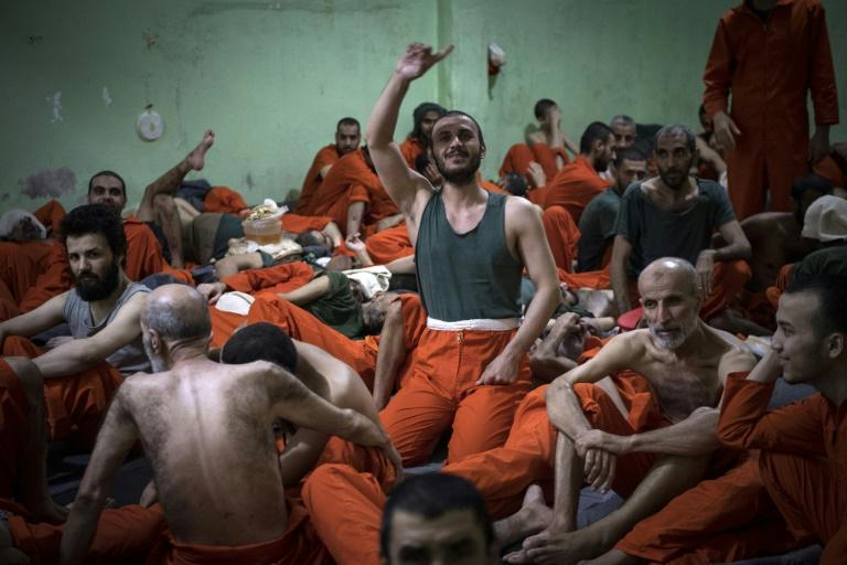 Men suspected of being affiliated with the Islamic State group in a prison in the northeastern Syrian city of Hasakeh in 2019