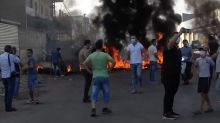 Riot police and protesters standoff in Lebanon