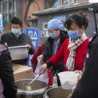 China's count of new virus cases drops, deaths exceed 2,200