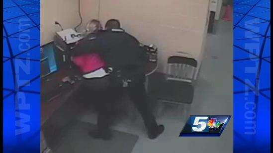 RAW VIDEO: Woman holds knife to officer's throat