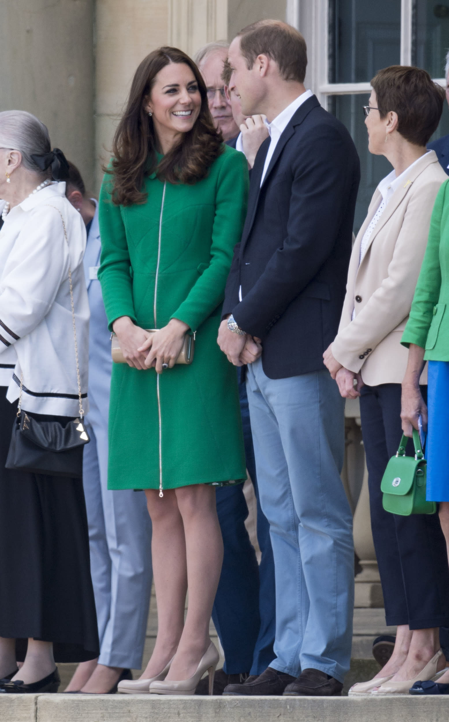 """Kate, William and Harry kicked off the Tour de France in July. Kate was wearing her green Erdem coat and <a href=""""https://www.amazon.com/L-K-Bennett-Womens-Sledge-Platform/dp/B01KW7DNG8"""">favorite L.K. Bennett sledge pumps</a>."""
