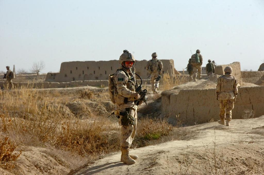 This photo obtained June 7, 2016 courtesy of National Defence / Government of Canada shows Colonel Jennie Carignan patrolling in Nakhonay, District of Panjwai, Afghanistan, in February 2010