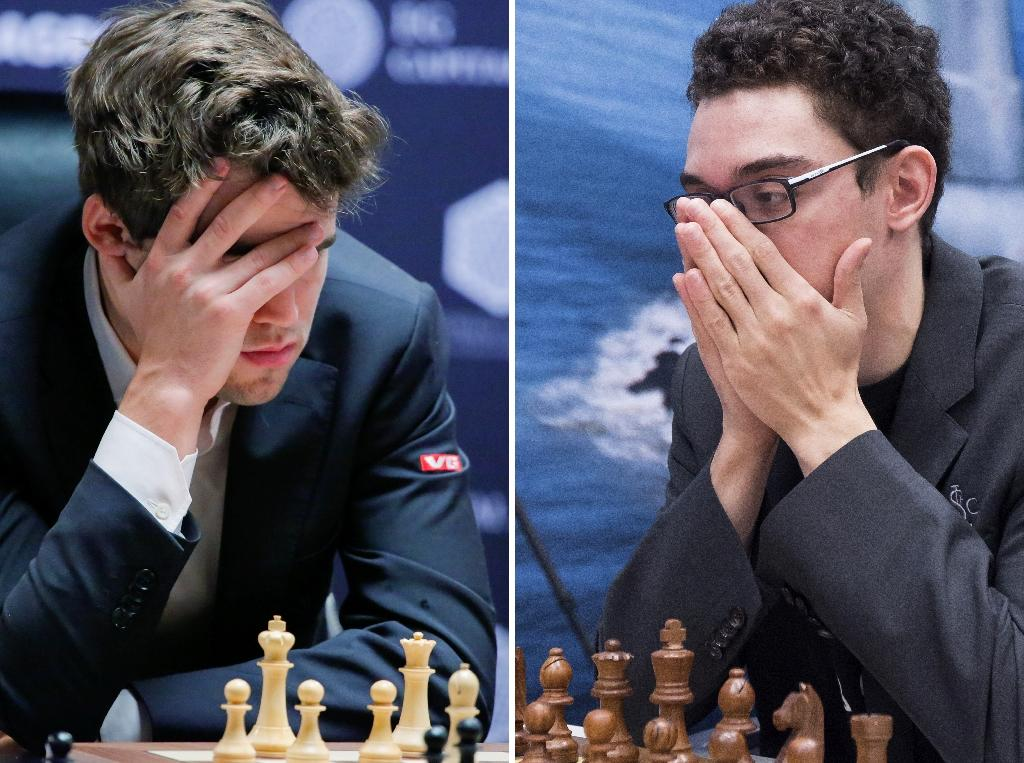 Norway's Magnus Carlsen (L, pictured November 6, 2018) and his American challenger Fabiano Caruana wrapped up their 12-match series in London with their 12th successive draw (AFP Photo/Kena BETANCUR, Koen SUYK)