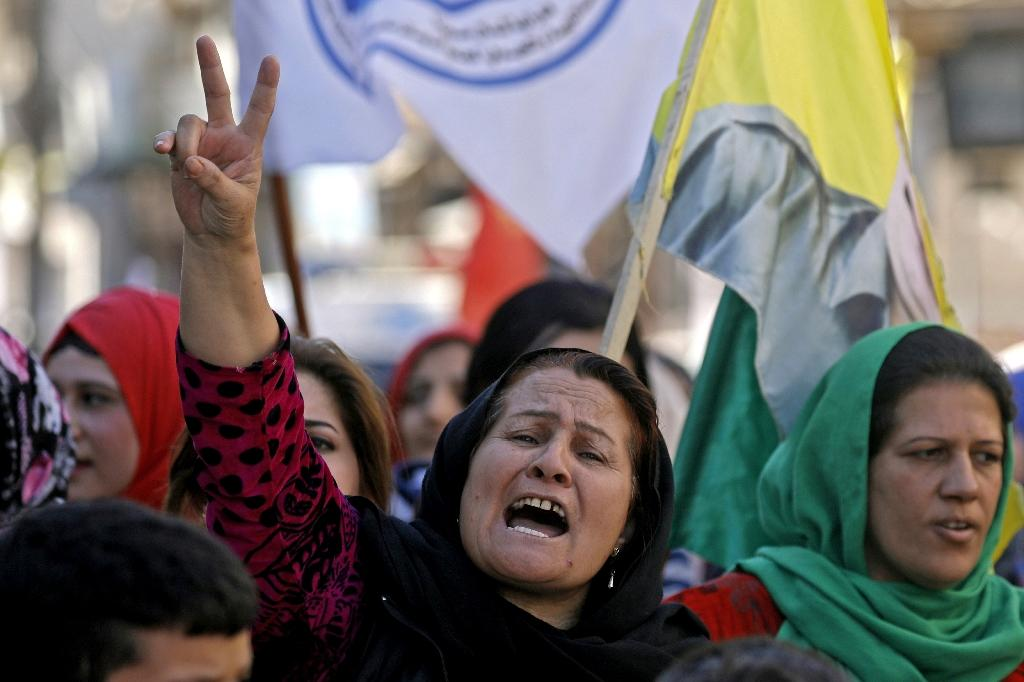Syrian Kurds demonstrate in Qamishli, northeast Syria, against Turkish shelling of Kurdish militia posts (AFP Photo/Delil SOULEIMAN)