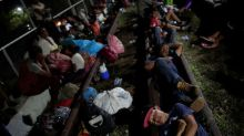 Hundreds in migrant caravan turn back, some trickle into Mexico