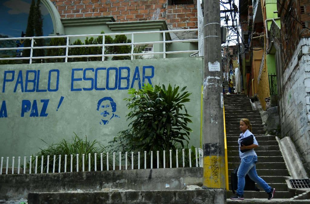 A girl walks in the Pablo Escobar neighborhood in Medellin, Colombia (AFP Photo/Raul Arboleda)