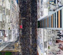Hong Kong leader apologises as massive rally chokes city