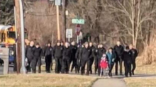 'In this family, nobody fights alone': Officers walk fallen deputy's son to school