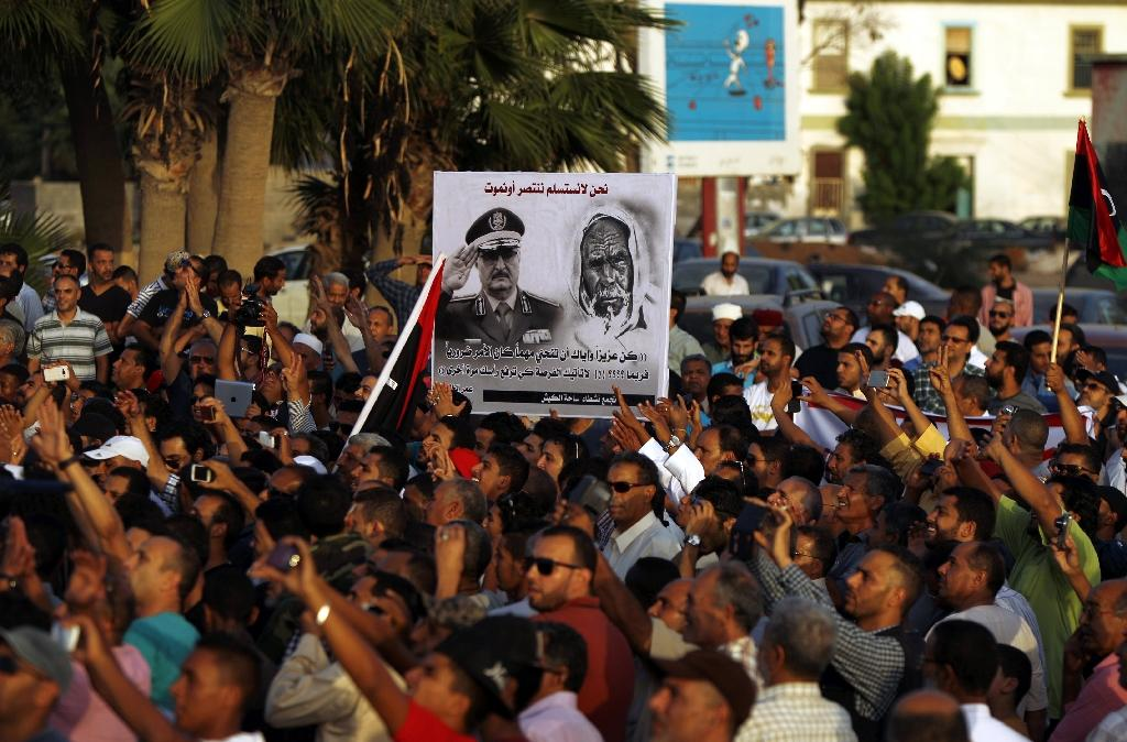 Libyan men take part in a protest against a national unity government proposal by United Nations envoy Bernardino Leon, in the eastern city of Benghazi, on October 9, 2015